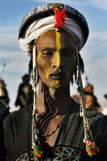 Peul Bororo (Wadabee) young man, dressed and made up for a beauty competition at the Aïr Festival. Iférouane, Niger, 2018.