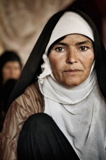 "Fatema, 40. ""In Afghanistan parents settle their daughters' future. I am one of those daughters. My father forced me to marry and old man, who is now 90 and has become mad. I win some bread selling goat milk but now with the saffron our life will get better"". 2011"