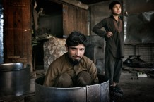 Mohammad Anwar, 30 years old, and Obaid, 11 years old, metal box makers. Jalalabad, 2012
