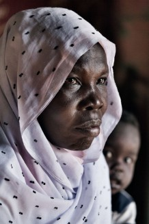 Trained midwife Aisha Salih Dawod Omer, 41 years old, at her home with her grandson. Um Khanger Almadrsa, Gedaref State, Sudan 2015