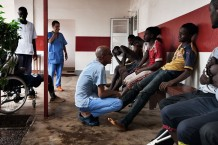 Surgical Centre, triage of a group of injured boys and a girl just arrived. Goderich, Freetown, Sierra Leone 2017