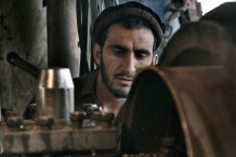 A worker of a factory of spare parts for engines and machines. Jalalabad, 2013