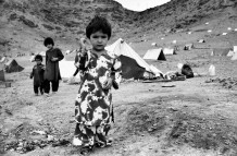In a refugee camp. Kabul, Afghanistan, 2003. After the end of 2001, three and a half million Afghans have repatriated from the refugee camps of Pakistan and Iran. The humanitarian organizations' aids were not enough, and most of the refugees found themselves once again in the camps.
