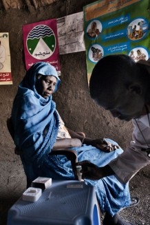 Bahria Alsadig, 37 years old, during her malaria test done by community health worker Saifeldin Abdalrahman Abdalkareem. Eventually the test was negative. Marin village, Rahad locality, Gedaref State. Sudan 2015