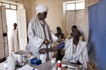 Health worker Mohammad Taha Onour, 60 years old, measuring the blood pressure of Shaiga Abu Fatima, 65 years old. Tahaday Oasis health unit, Kassala State. Sudan 2015