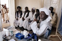 Health worker Mohammad Taha Onour, 60 years old, and his patients at Tahaday Oasis health unit. Kassala State, Sudan 2015