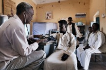 Medical assistant Ahmed Hassan Ahmed, 51 years old, visitingl Mohamed Idris, 20 years old, suffering of pain in the back. Ardalhager health centre, Girba locality, Kassala State. Sudan 2015