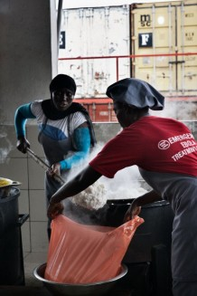 Surgical and Paediatric Centre, kitchen. The cooks prepare all the meals for patients, hospitalized children's mothers and the staff. In the background some of the hospital containers. Goderich, Freetown, Sierra Leone 2017