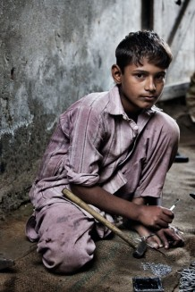 Child labour, surgical instruments production. Jharian Wala, Sialkot District, Punjab. Pakistan, 2013